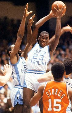 Jordan pulls down a rebound in an ACC game against Virginia in January 1982. James Worthy & Brad Daughtery also in photo for UNC