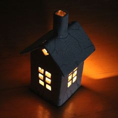 Candle house lit up. Looks so Halloweenish!