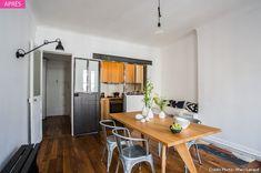 Aménager une cuisine en longueur en lui apportant un style industriel. Comment disposer les meubles dans seulement 3 m2? Quelles couleurs opter pour éviter l'effet couloir ? Réponses avec des matières brutes et des harmonies de noirs et de blancs. Sans oublier la verrière.