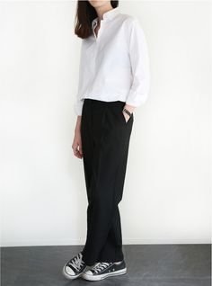 White, button-down shirt; black trousers; Chuckies