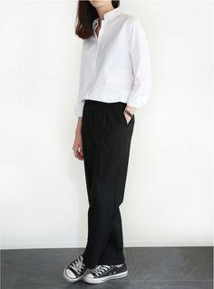 White, button-down shirt; black trousers; Chuckies