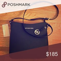 Michael Kora purse Black Michael Kors purse that is Brand new and never been used. It still has the tags on! MICHAEL Michael Kors Bags Shoulder Bags