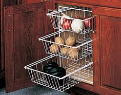 Kitchen space saver - I wouldn't put food down there but drawers would be neat for organizing under the sink.