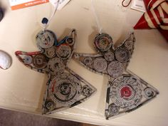 Angels made from coiled recycled newspaper in the Philippines.