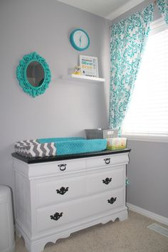 Project Nursery - I like the top of the dresser painted black. Looks elegant!