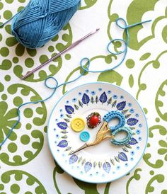 Crochet scissor grips. I love this because it's like yarn can reach out and decorate just about anything.