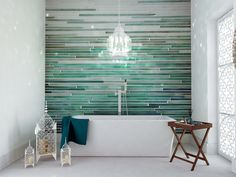 Inspiration from Bathrooms.com: As one of the key colour trends for 2015, the 'peacock' palette continues as a signature look for autumn. This harmonious blend of tones and textures celebrating all the colours of the king of birds – the peacock – including deep blues, royal turquoises and jade greens. A feature tiled wall with a variation of theses peacock tones will bring your bathroom to life, and work perfectly alongside contemporary bathroom suites.
