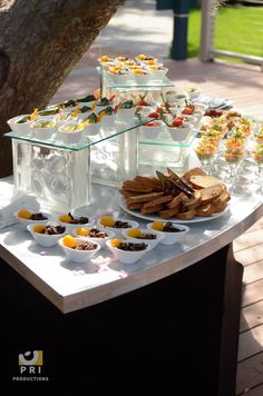 Outdoor table set up for wedding guests' appetizers