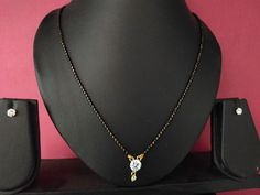 designer round solitaire cubic diamond mangalsutra pendant with earrings  #panassh