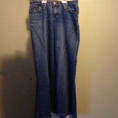 Long denim skirt Great condition besides a little unsown piece on the backside pocket.Overall super cute!!! Skirts A-Line or Full