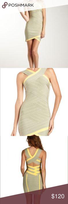 "Stretta Crisscross Bandage-Seam Dress. Green Heather/Yellow. Overlapping crisscross bandage seaming. Crisscross neckline and cutout back. Sleeveless. Formfitting silhouette. Asymmetric hem. Hidden side zip. Approx. 29""L down front; 31 3/4""L down back. Rayon/spandex; dry clean. Imported. Stretta Dresses"