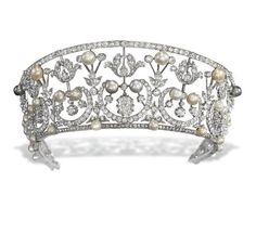 BELLE EPOQUE TIARA, kokoshnik design, the old-cut diamond foliate openwork band interspersed with button-shaped cultured pearls and (untested) pearls of varying hues, the centre set with a cushion-shaped diamond, adapted, circa 1905