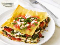 This warm-weather Grilled Lasagna is prepared on the grill in a foil packet. The spinach filling makes it a great main dish option for a vegetarian-friendly cookout.