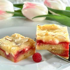 Razz-Ma-Tazz Bars ~ A scrumptious blend of raspberry preserves, Nestlé Toll House Premier White Morsels and toasted almonds tops a rich, buttery cookie crust to create these irresistible Razz-Ma-Tazz cookie bars.