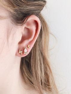 SHOP Statement ear studs with lightning bolt gold ear design, small dainty moon and white opal earrings. Great earrings studs for stacking and layering, fun playful classic designs and motifs for the magic witch, luna goddess, magic makers, dreamers and healers. Click to shop gold ear studs jewellery by AU REVOIR LES FILLES.