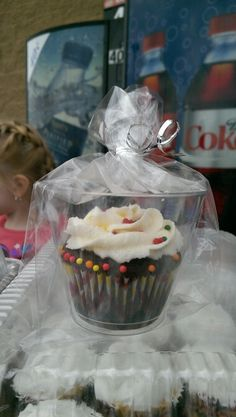 Great idea for fund raisers. Put cupcakes in a clear plastic glass and wrap in cellophane. No crushed frosting to deal with. Also presents great!