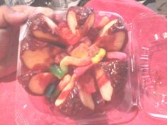 chamoy covered candy apple with sour gummy worms