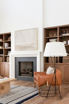flooring lamp Shop Lebon Floor Lamp, Linder Leather Arm Chair, Ansel Woven Rug, Gulf Shores, Rattan Magazine Basket and Fireplace Built Ins, Home Fireplace, Fireplace Surrounds, Fireplace Design, Simple Fireplace, Basement Fireplace, Fireplace Ideas, Stucco Fireplace, Fireplace Furniture