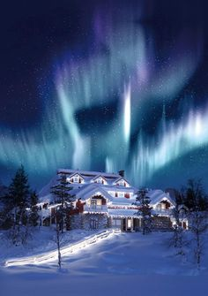 Northern Lights over Santa's Home at Hotel Kakslauttanen, Finland.
