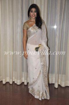 serene simple white saree in gold border...