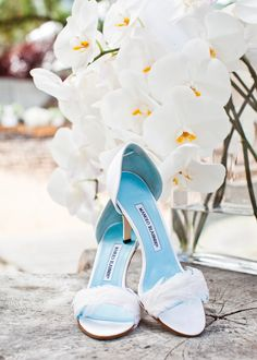 Blue-lined and feathered Manolo Blahniks | Photography: Kate Webber - katewebber.com  Read More: http://www.stylemepretty.com/california-weddings/2014/04/23/elegant-durham-ranch-wedding/