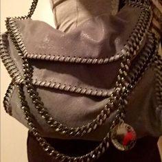 Stella McCartney bag Firm !!! Authentic Stella McCartney Falabella bag beautiful great condition . Gray Metallic gunmetal hardware . No stain rips tear hardware shines . Stella McCartney Bags