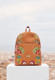 043e57e8e8175 Camel backpack with rounded finishes and embroidered Indian floral art. The  embroidered Indian flowers balance