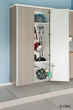 This slide out basket solves the problem of basketball, football and soccer ball storage - and keeps them neat and tucked away in cabinetry to get rid of clutter in the garage. Learn 3 steps to an organized garage in this article. Girls Closet Organization, Garage Organization Systems, Garage Storage Solutions, Small Bathroom Organization, Organizing Solutions, Workshop Organization, Organization Ideas, Garage Accessories, Garage Cabinets
