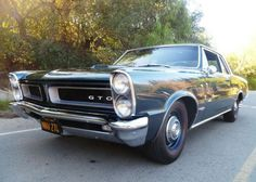 This 1965 Pontiac GTO post coupe (chassis 237275K109520) is described as a PHS-documented example with a verified 124k miles and two Souther...