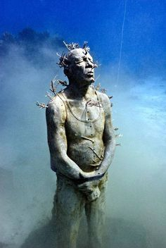 The work in the West Indies and his current project for the Cancun Underwater Museum (already billed as the largest underwater sculpture park ever built) combine his artistic talents with his passion for the sea. The sculptures are designed specifically to create artificial reefs for marine life to inhabit and colonize. Underwater Sculpture, Underwater City, Sculpture Art, Christ Of The Abyss, Jason Decaires Taylor, Batman Poster, Water Art, Science And Nature, Under The Sea