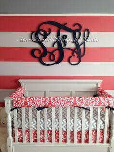 Love the black monogram over the striped wall. And what a gorgeous color scheme!