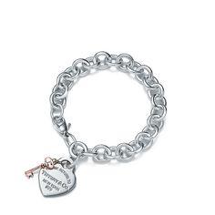 Return to Tiffany® heart tag key bracelet in sterling silver and RUBEDO® metal.   Tiffany & Co.