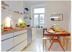 white scandinavian kitchen design with black table, pendant, bench