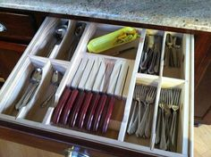 My husband built me custom drawer liners for all my kitchen tools.  This drawer houses our utensils.  He even created a knife block for our steak knives.