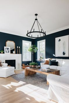 family room with light ceiling, navy accent walls, hardwood floors, white coaches, and a white tiled fireplace Navy Accent Walls, Blue Walls, Living Room Designs, Living Room Decor, Living Rooms, Family Rooms, Country Wall Mirrors, Decorating Your Home, Diy Home Decor