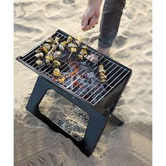 Folding Portable Charcoal Grill in Barbecue | Crate and Barrel