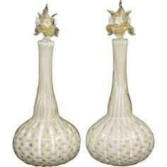 Offered is a pair of Murano glass bottles or decanters, made by Alfredo Barbini around the 1950s or so.  They are ribbed with Bullicante (controlled