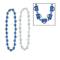 The Oktoberfest Beer Mug Beads are a necklace of blue and silver beer mugs. Each strand of the beer mug beads measures 33 inches long and are made of plastic.