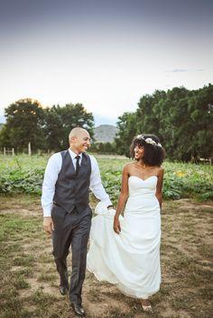 Groom-holds-brides-dress #naturalhairbride
