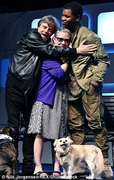 Franchise family: The trio looked thrilled to be reunited as they stopped for a hug - while Gary looked on from the ground