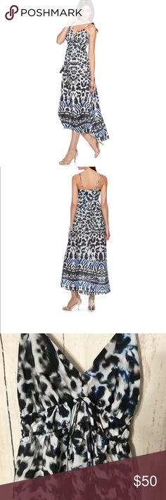 Jlo Animal Print Maxi Dress Size Small  This women's Jennifer Lopez cami maxi dress is perfect for your summertime style.   PRODUCT FEATURES 	•	Colorful print 	•	Tassel detail decorates the bodice  	•	Scoopneck 	•	Adjustable straps FIT & SIZING 	•	50 1/4-in. approximate length from shoulder to hem 	•	Maxi length FABRIC & CARE 	•	Polyester 	•	Machine wash 	•	Imported  White black grey blue and light olive Jennifer Lopez Dresses Maxi