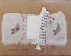 Stitched textile collage on brown paper, birds in flight, original art
