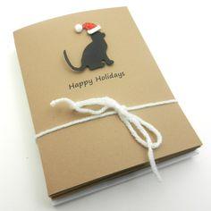 Black Cat Silhouette with Santa Hat, via Etsy.