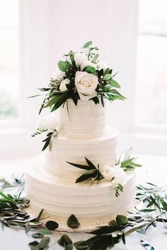 Sophisticated white wedding cake with greenery and pretty textures | Stephanie Rogers Photography