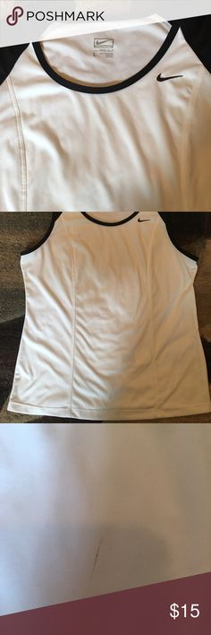 NWOT nike performance top! NWOT Nike performance top! Excellent condition except small mark in middle front of shirt! Unsure how it got there and could possibly come out just haven't washed it. Nike Tops