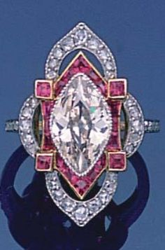 A Belle Epoque diamond and ruby ring, circa 1910. The quatrefoil bezel millegrain-set to the centre with a lozenge-shaped diamond, within an openwork border of calibré-cut rubies and rose-cut diamonds, French assay mark. #BelleEpoque #ring