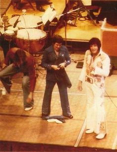 """David E. Stanley: """"Me, Charlie Hodge and Elvis during a concert in the 70s. I was always on alert when Elvis was on stage. Many fans would try and jump up on the stage just to get to him. Most did not want to hurt him they just wanted to hug him. Working for Elvis from 1972 to 1977 was awesome. So many concerts so much history."""" ~ FB"""
