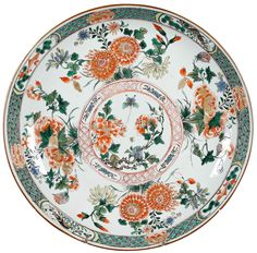A large Chinese export porcelain famille verte dish. Kangxi period. Painted in famille verte enamels, with flowers, peonies, chrysanthemum. On the rim, for panels with carps and shrimps.