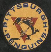 The first logo featured a skating penguin with a scarf holding a hockey stick in front of a golden triangle emblematic of the city's Golden Triangle.