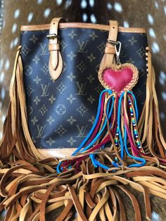 ab1490513b03 Louis Vuitton authentic upcycled pm bucket bag with long leather fringe! Bag  charm included! Ready to ship!